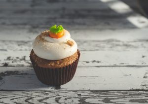 A cupcake on wood table